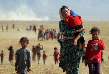 RefugeeYazidisFleeingAugust112014ReutersViaTimeMag