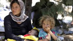 YazidiFamilyandGirlFleeingIsisRestingAtBorderReuters