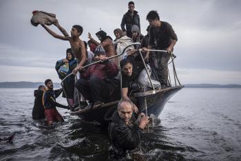 RefugeeBoatPullSergeyPonomarevNYT