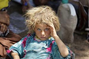 YazidiGirlFleeingIsisRestingAtBorderReuters